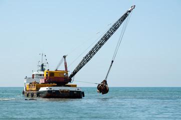 Barge dredging a harbor