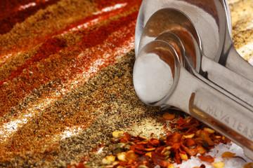 hot seasoning of taco ingredients with measuring spoons