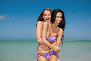 Happy lesbian couple at the beach