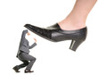Businessman is kicking by a big foot of a woman