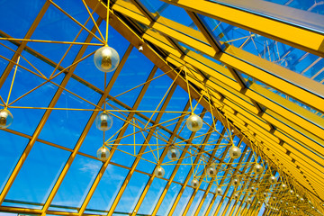 Yellow abstract ceiling in office