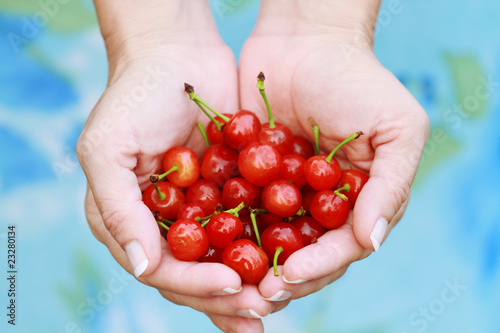 Woman Holding Cherries