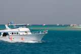 White tourist yachts for diving at paradise island