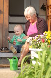Grandmother with grandchild sitting on a stair_outdoor