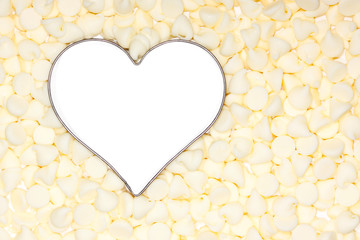 white chocolate morsels surround a silver heart