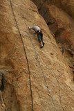 Rock climber on sheer cliff,Smith Rock State Park,