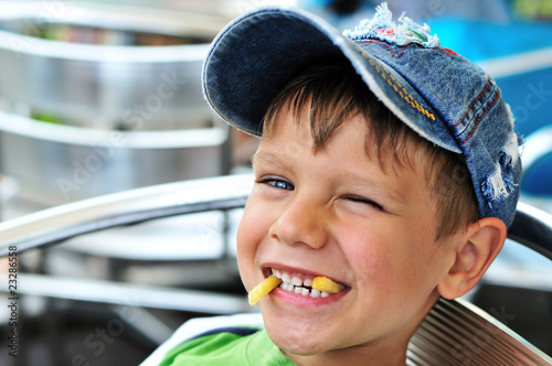 little boy enjoying french fries