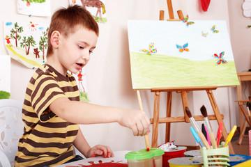 Child paint picture in preschool.