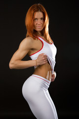 Portrait of cute sportswoman. Studio shot