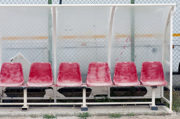 Old and damaged bench on a public football pitch