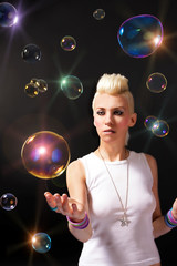 Blonde girl with soap bubbles