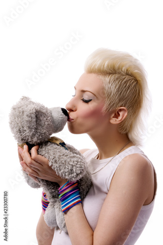Beautiful girl with blonde hair and Teddy