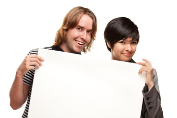 Attractive Diverse Couple Holding Blank White Sign