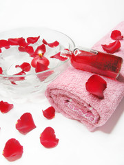 spa bowl with rose petals and oil essences