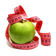 measuring ribbon and apple for diet
