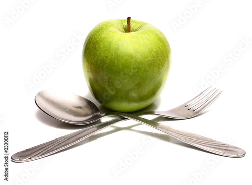 spoon fork and green apple for diet