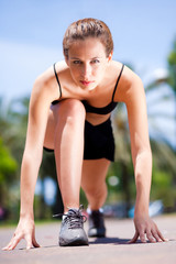 Young fitness woman ready to run