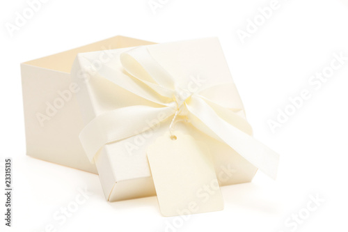 partially opened cream colored gift box