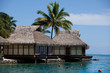 Water bungalows in the lagoon of  Moorea. French Polynesia