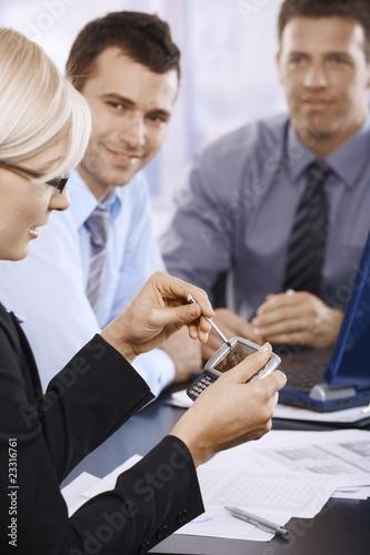 Leinwandbild Motiv Businesswoman using PDA