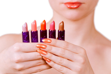girl holding five lipsticks