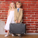 little boy and girl with bag. Travel or relocation. Series poster