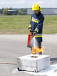 Fire fighter using extinguisher