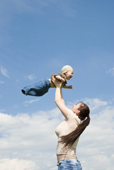 mother playing with baby in the sky