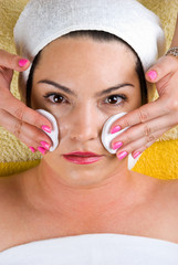 Woman getting cleansing face