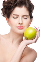 Close up portrait of beauty woman with green apple.