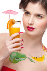 Close up portrait of beauty woman with fruit bodyart and juice