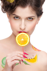 Close up portrait of beauty woman with fruit bodyart and juicy o