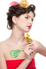 Close up portrait of beauty woman with fruit bodyart and fruit c