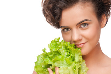 Closeup portrait of emotional beauty woman with green lettuce