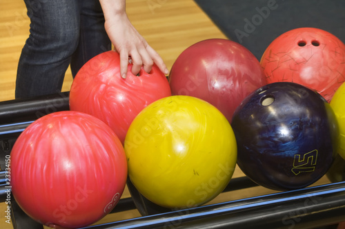 Bowling ball in player woman hand