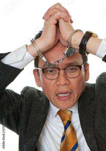 Manager mit Handschellen
