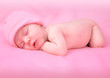 Newborn Baby Girl Sleeping on Pink
