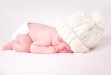 Little Newborn Baby Sleeping on White Background