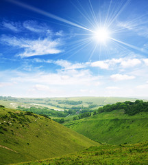 Sun over valley