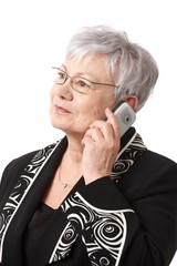 Closeup portrait of senior lady with mobile phone