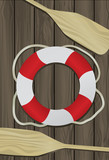 Life Buoy and two Boat Oars on a deck background