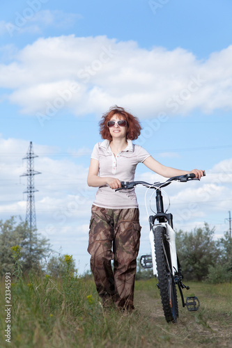 Woman riding bike in countryside
