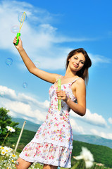 teen girl blowing soap bubbles
