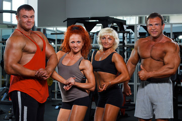 Women and men demonstrate the musculars in a health club