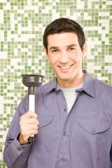 Happy plumber portrait