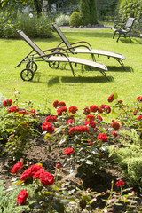 Deck chair in a green garden