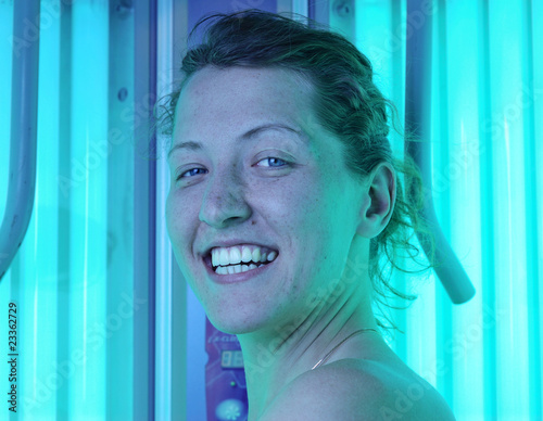 beautiful woman in vertical solarium