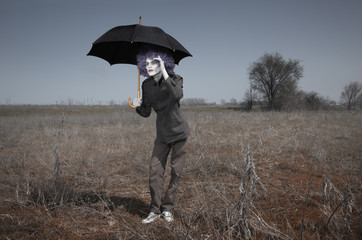 Funny man and umbrella