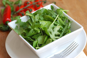 Mixed leaf salad in a square bowl