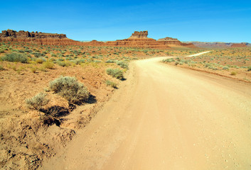 old desert dirt road in monument valley utah